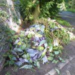 afval buiten het hek